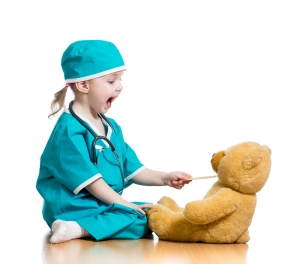 shutterstock_130944353 - girl & teddy